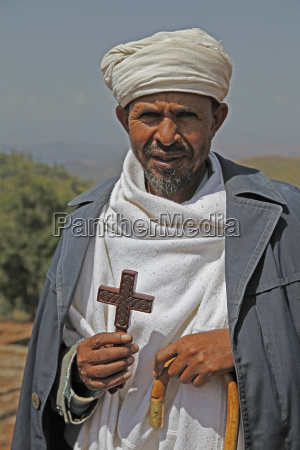 orthodox priest hold cross at the