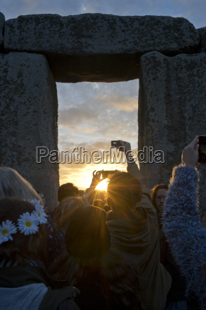 revellers gather at historic monument for