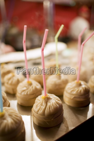 chicken soup dumplings with straws for