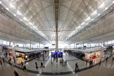 passengers at hong kong international airport