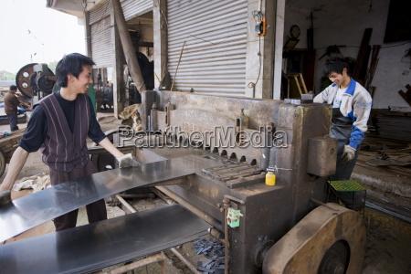 men working at metal recycling steel