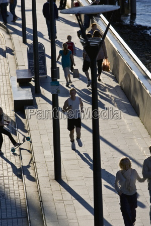 pedestrians and jogger on thames path