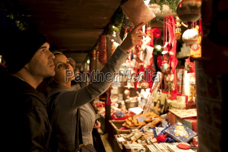 customers shopping for christmas ornaments at
