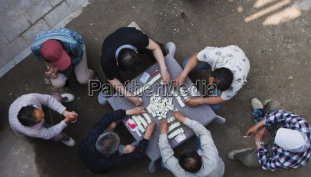 overhead view of chinese men sitting