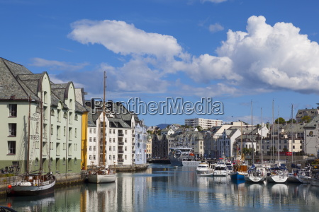 old fishing warehouses in harbour alesund