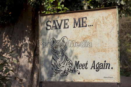 save tiger poster at exit of
