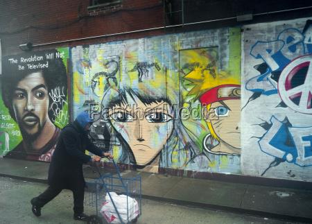man and grafitti new york united