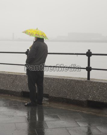 a man waits in the rain