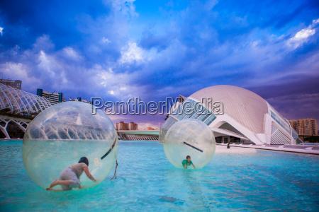 kids playing in floating orbs hemispheric