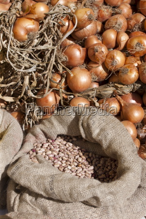 onions and dried borlotti beans on