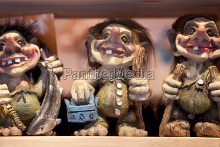 traditional trolls on display in tromso