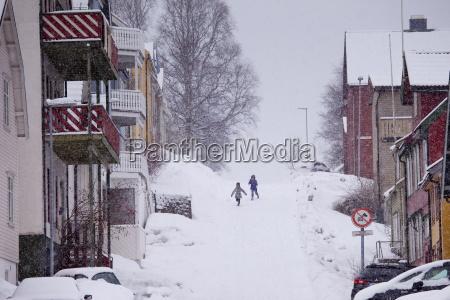 children running in the snow in