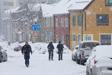 locals walking in the snow in