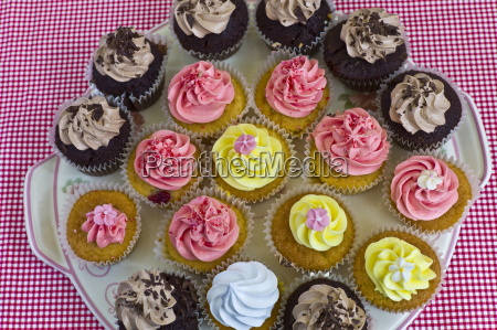 brightly coloured cup cakes on sale