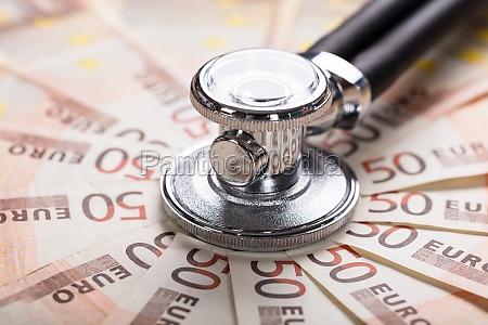 stethoscope on euro banknote