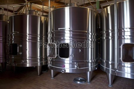 stainless steel wine vats at chateau