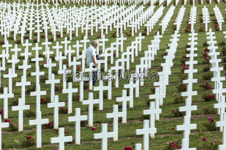 man visiting the cemetery of douaumont