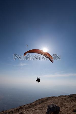 paragliders flying over mount cuarnan udine