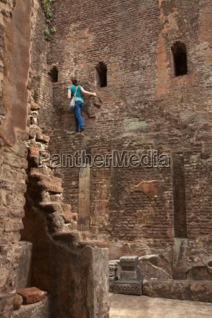 woman explores lankatilaka image house polonnaruwa