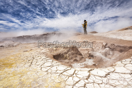 a man walks around the craters