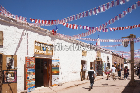 calama street decorated with streamers for