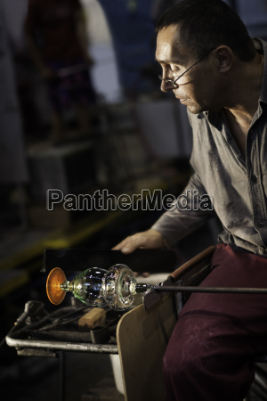 male glass blower at moser glass
