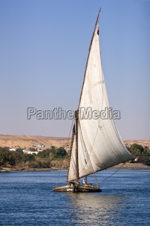 old felucca laden with rocks on
