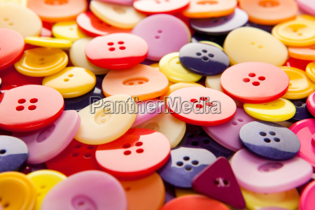 a bunch of colorful buttons with