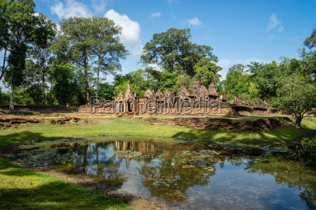 a deserted temple reflected in a