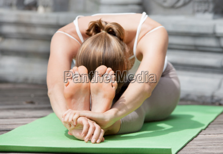 young woman doing yoga in abandoned
