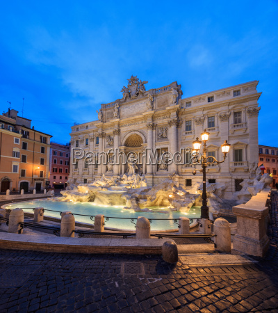 panorama of trevi fountain illuminated by
