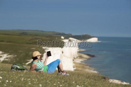 a woman reads her ipad on