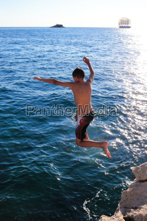 child jumps from cliff into the