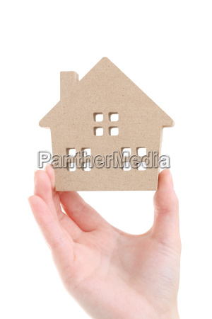 hand holding miniature model of house