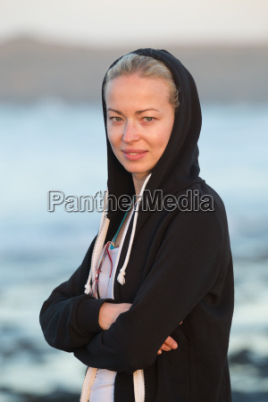 sporty woman on sandy beach at