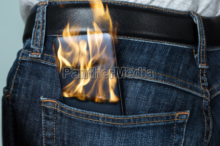burning phone in jeans
