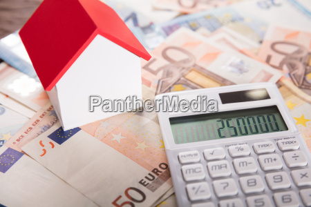 house model on euro bank note