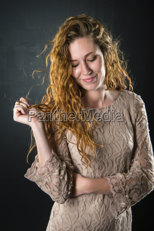 young woman looking down smiling close