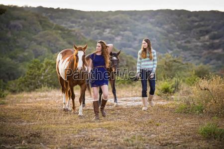 usa texas sisters walking with quarterhorses