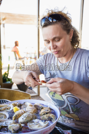 mature woman enjoying meal of fresh