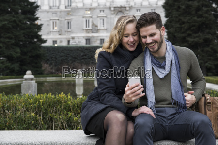 spain madrid happy couple with cell