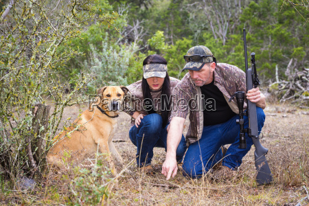 father and daughter with blackmouth cur