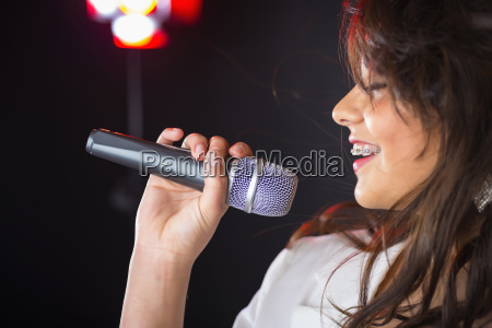 usa teenage girl performing on stage