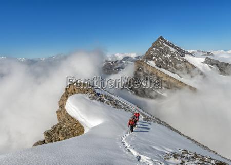 switzerland western bernese alps mountaineers in