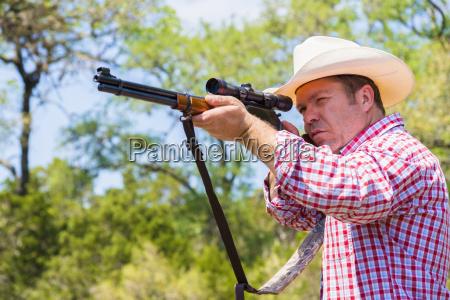 texas cowboy shooting hunting rifle close