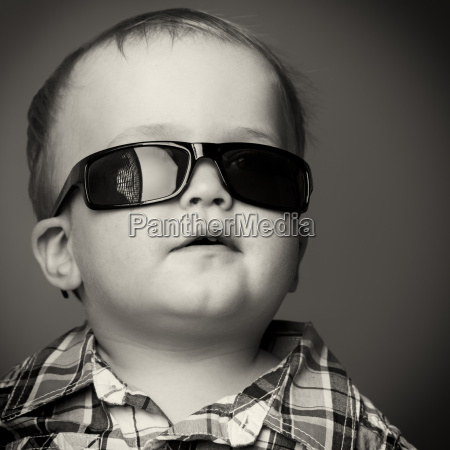portrait of a toddler wearing sunglasses