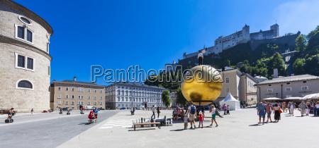 austria salzburg golden ball sculpture on