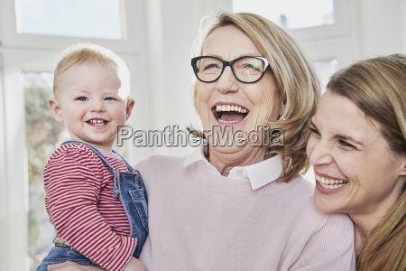 happy grandmother mother and baby girl