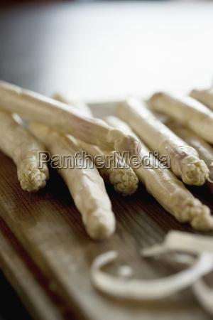 white asparagus on chopping board close