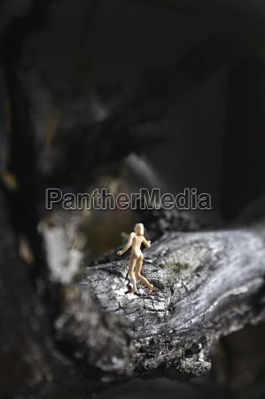 naked figure walking on stub